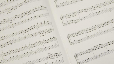 Tracking-Shot-Pulling-Away-from-Music-Sheet-Book
