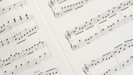 Tracking-Shot-Over-Pages-of-Music-Sheet-Book