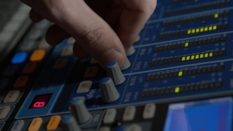 Close-Up-Shot-Tracking-Sound-Mixers-Hand-Adjusting-Knobs-On-Sound-Board