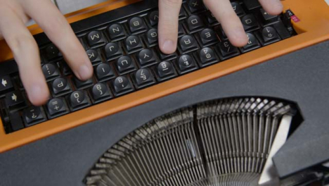 High-Angle-Shot-Looking-Down-On-Hands-Using-Typewriter