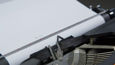 Tracking-Shot-from-Typewriter-Keytop-to-Page-as-Writer-Types-The-End