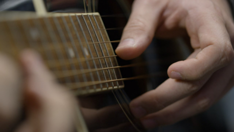 Sliding-Close-Up-Shot-of-Musician-Playing-Acoustic-Guitar