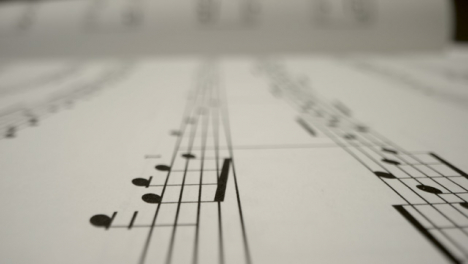 Tracking-Shot-Over-Bars-On-the-Page-of-Music-Sheet-Book