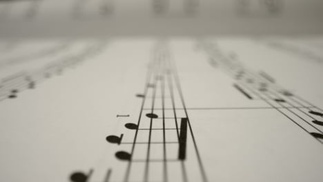 Tracking-Shot-Over-Bars-On-the-Page-of-a-Music-Sheet-Book