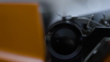 Sliding-Extreme-Close-Up-Shot-of-Typewriter-Carriage-Being-Returned-After-Typing-