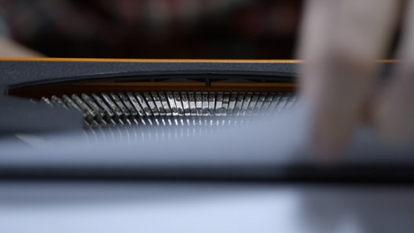 Close-Up-Shot-of-Typewriter-Typebars-as-Writer-Finishes-Typing-and-Pulls-Page