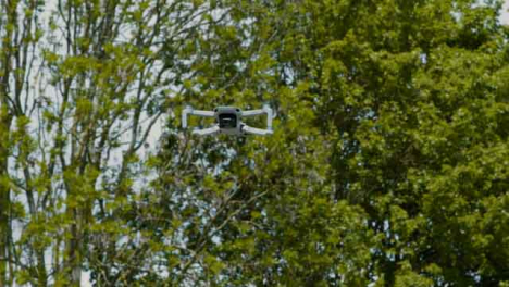 Low-Angle-Shot-Looking-Up-at-DJI-Mini-2-Drone-Flying-Overhead