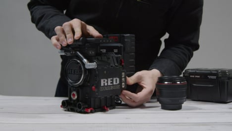 Wide-Shot-of-Person-Preparing-RED-Dragon-Cinema-Camera-for-Filming-Part-1-of-2