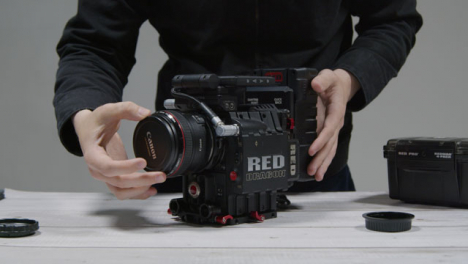Wide-Shot-of-Person-Preparing-RED-Dragon-Cinema-Camera-for-Filming-Part-2-of-2