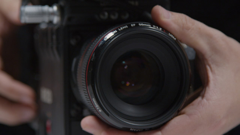 Close-Up-Shot-of-Person-Adjusting-Focus-On-Lens-and-Using-Touchscreen-Monitor