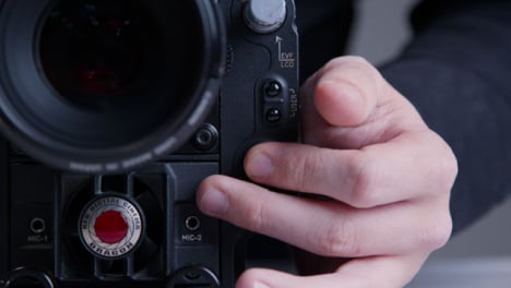 Close-Up-Shot-of-Person-Hitting-Record-Button-On-RED-Dragon-Cinema-Camera
