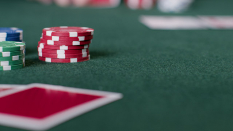 Sliding-Shot-of-Pair-of-Cards-and-Poker-Chips-