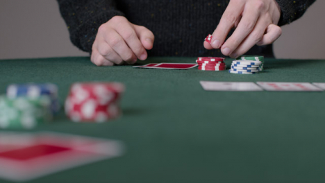 Long-Shot-of-Poker-Player-Thinking-and-Placing-Bet