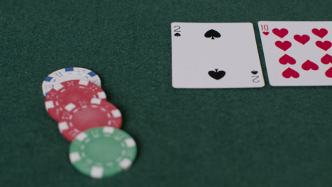 Tracking-Close-Up-Shot-from-Cards-to-Chips-Being-Bet