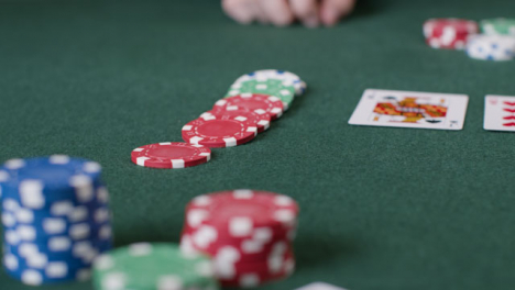 Close-Up-Shot-of-Poker-Chips-Being-Bet-