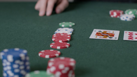 Close-Up-Shot-of-Poker-Chips-Being-Bet-by-Player