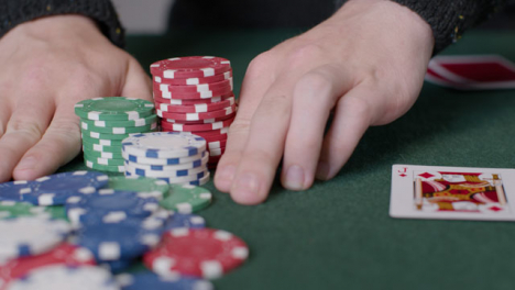 Tracking-Close-Up-Shot-of-Poker-Player-Going-All-In
