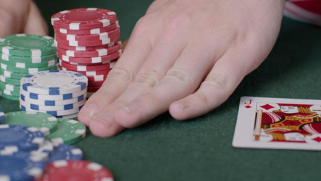 Tracking-Close-Up-Shot-of-a-Poker-Player-Going-All-In