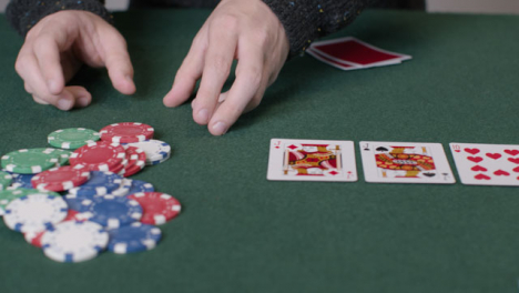 Tracking-Shot-Orbiting-Community-Cards-as-Poker-Player-Shoves-All-In