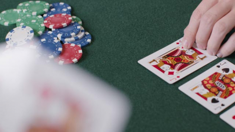 High-Angle-Shot-of-Turn-Card-During-Poker-Game-and-Player-Betting