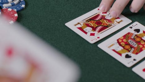 High-Angle-Shot-of-Turn-Card-During-a-Poker-Game-and-Player-Betting