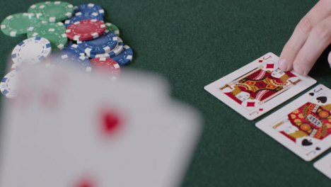 High-Angle-Shot-of-Turn-Card-During-Poker-Game-and-Players-Betting-and-Folding