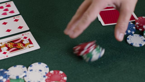 High-Angle-Shot-of-Poker-Player-Checking-Cards-Before-Betting-