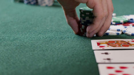 Tracking-Close-Up-Approaching-Pot-as-Poker-Player-Goes-All-In