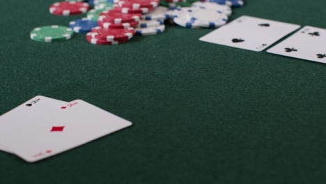 Tracking-Shot-Orbiting-Pot-as-Poker-Player-Shows-Aces