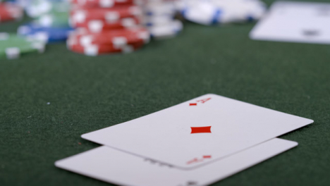 Extreme-Close-Up-Shot-of-Poker-Player-Turning-Over-Pocket-Aces