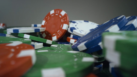 Sliding-Extreme-Close-Up-Shot-Over-a-Pile-of-Poker-Chips
