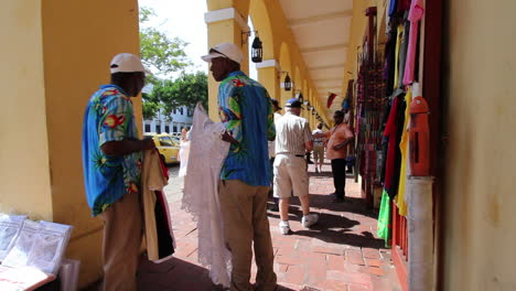 Cartagena-Colombia-men-on-sidewalk-with-tablecloth