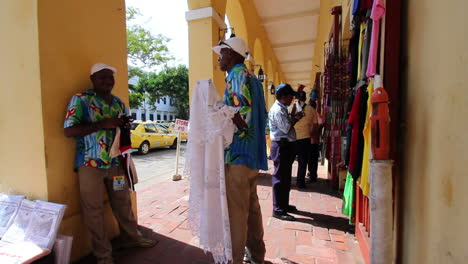 Cartagena-Colombia-men-with-tablecloth-by-craft-shop