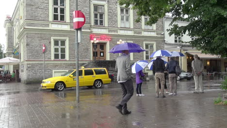 Tallinn-Estonia-on-a-rainy-day-with-people-and-a-yellow-taxi