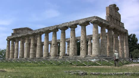 Italy-Paestum-Temple-of-Athena-with-man-walking