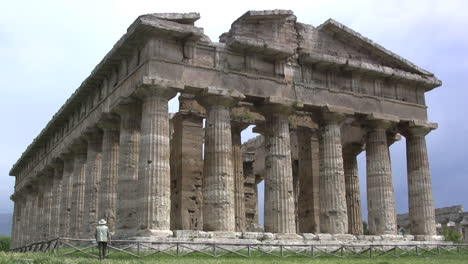 Italy-Paestum-Temple-of-Neptune-with-man-mov