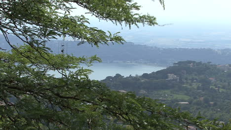 Italy-branches-frame-a-view-of-Lake-Albano