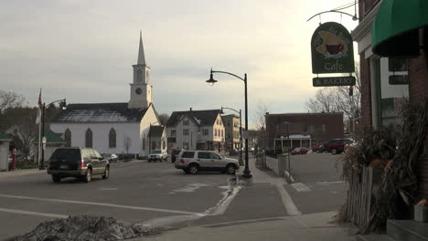 Newmarket-New-Hampshire-town-street-with-church-and-sign