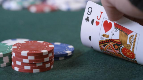 Extreme-Close-Up-Shot-of-Poker-Player-Checking-Cards-Before-Betting