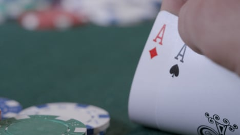 Extreme-Close-Up-Shot-of-Poker-Player-Looking-at-Their-Pocket-Aces