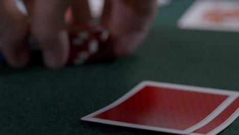 Extreme-Close-Up-Shot-of-Poker-Player-Looking-at-Seven-Deuce-Before-Bluffing