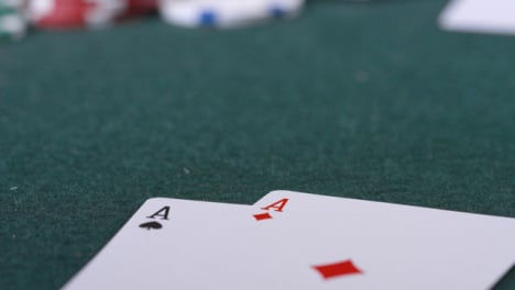 Extreme-Close-Up-Shot-of-Poker-Player-Going-All-In-and-Revealing-Pocket-Aces