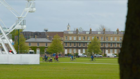 Sliding-Shot-Revealing-Cyclists-In-Parkers-Piece