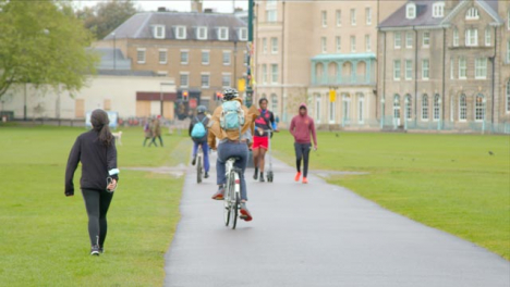 Long-Shot-of-Cyclists-and-Pedestrians-Passing-Through-Parkers-Piece