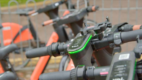 Tracking-Shot-Passing-Over-Handlebars-of-Electric-Scooters