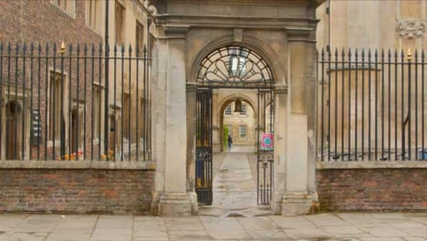 Tracking-Shot-Past-Entrance-of-Peterhouse-College-