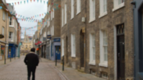 Defocused-Tracking-Shot-Down-a-Quiet-English-Shopping-Street-