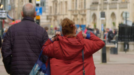 Tracking-Shot-Following-Adult-Couple-In-Street