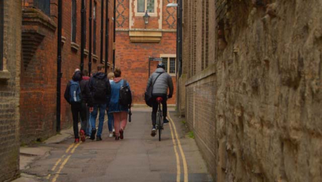 Tracking-Shot-Following-Pedestrians-and-Cyclists-In-Quiet-Backstreet