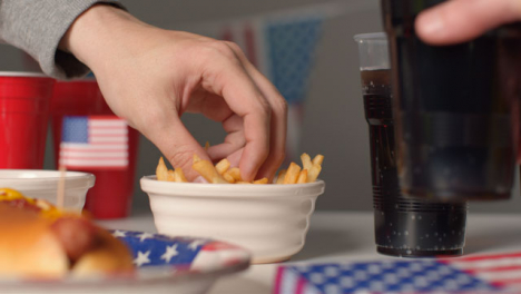 Sliding-Shot-Approaching-Bowl-of-Fries-as-Hand-Takes-Some